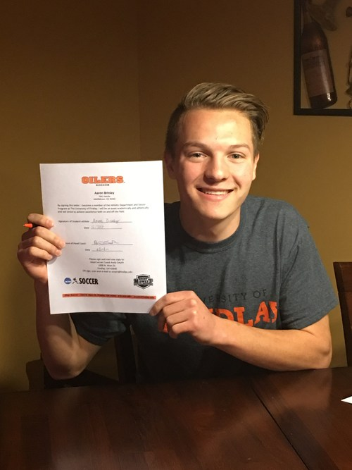 AJ holding his commitment letter to the University of Findlay