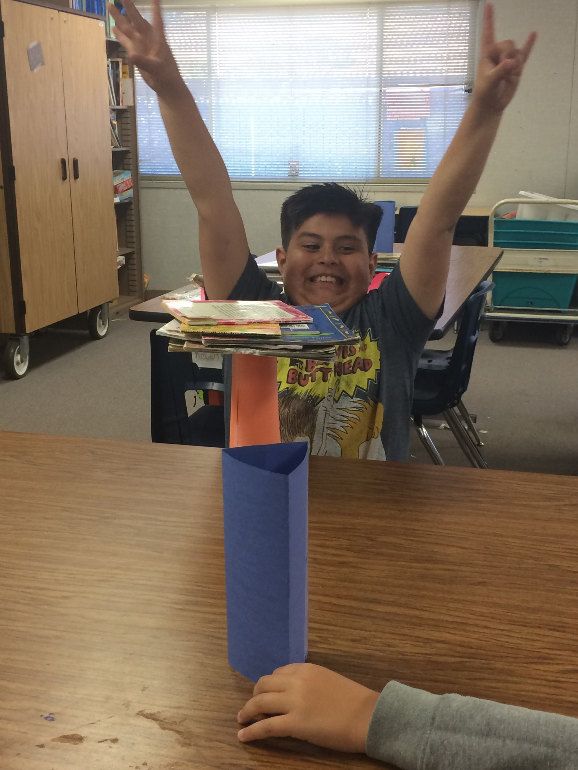 TEM Challenge: Stacking books onto different shaped paper,how many books will they hold?