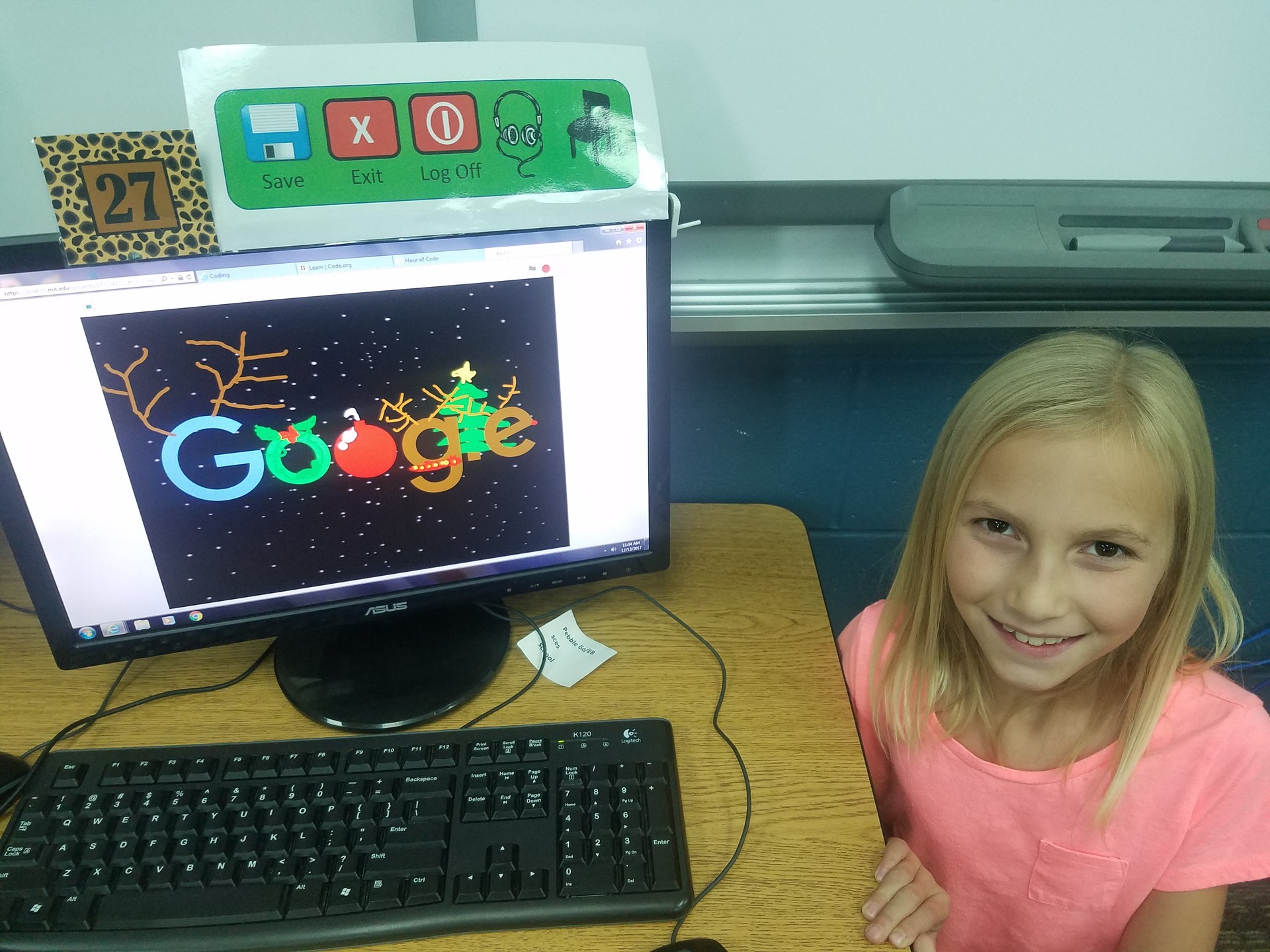 Student creating a Google Logo