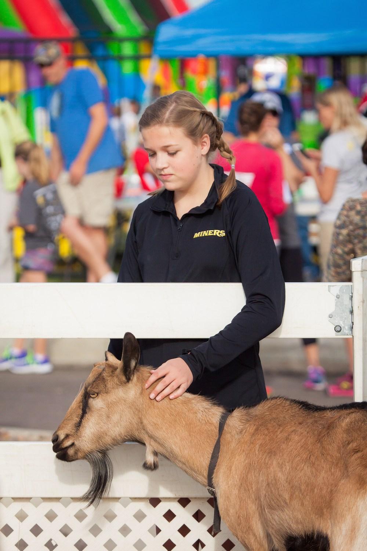 PRA Student petting Goat