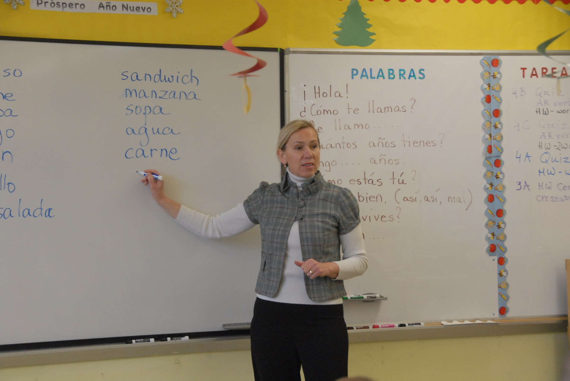 Spanish teacher showing words on board