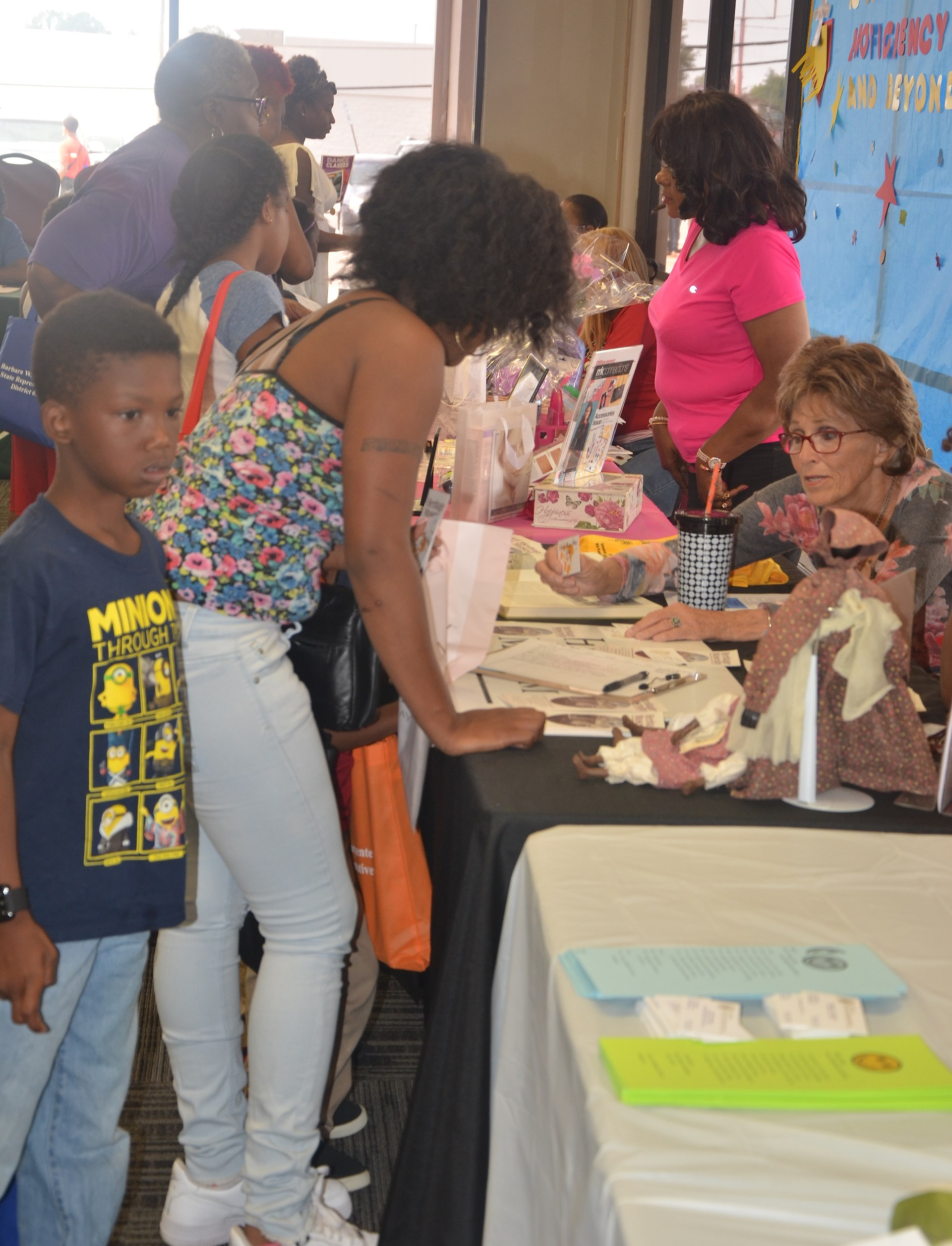 A young boy and adult lady checking out of the stations at the 2017 Back To School Expo
