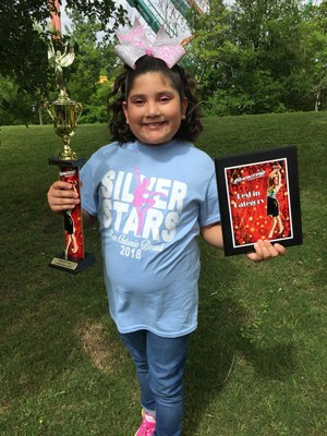 She participated with The Silver Stars Dance team in San Antonio