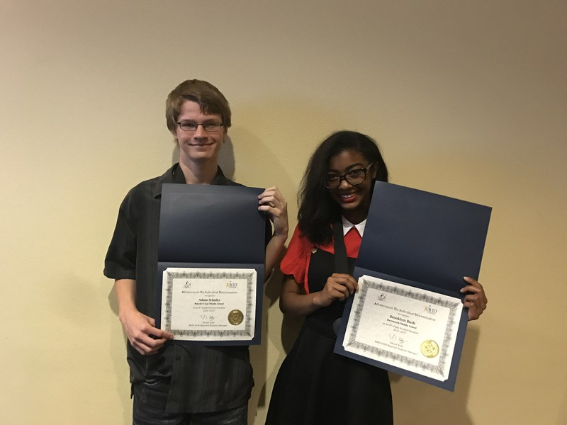 Adam Shultz and Brooklyn Bush holding their certificates.