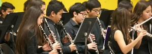 Several students playing woodwind instruments