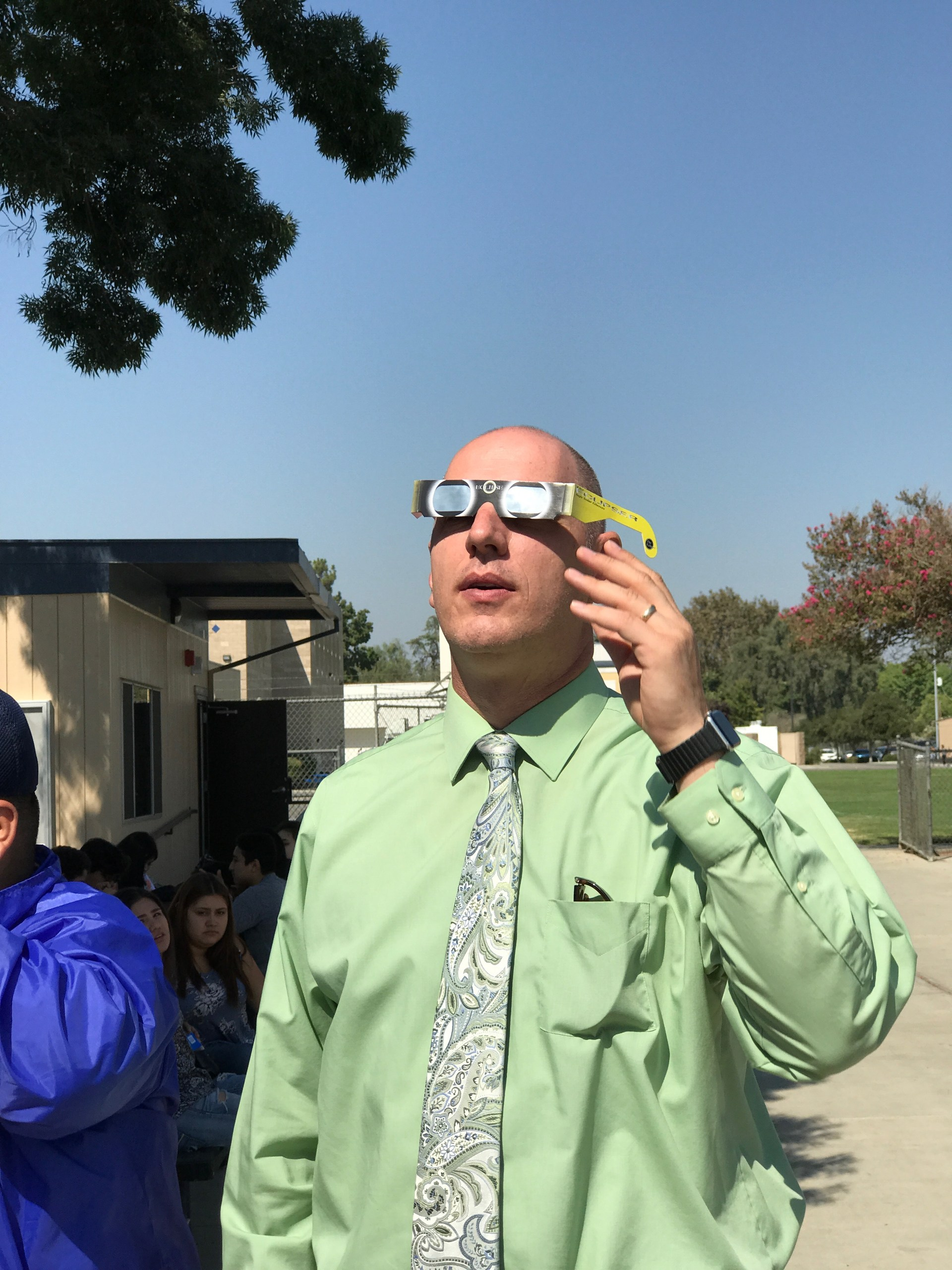 Mr. Johnson observe the solar eclipse