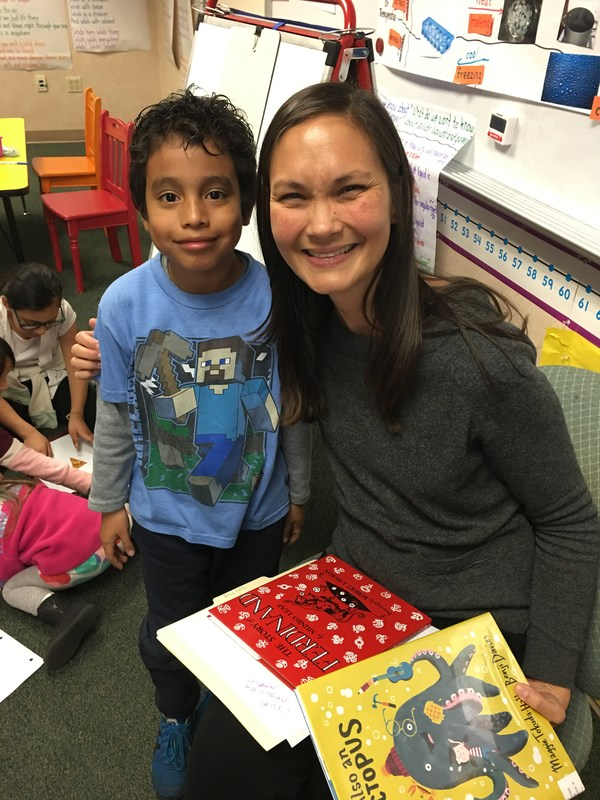 student poses with guest reader, former teacher Amy Lee