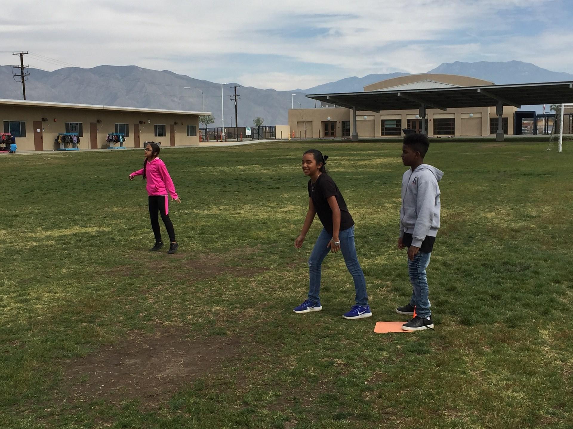 student running to third base