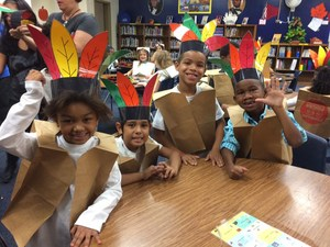 1st grade students prepare for the Thanksgiving performance.