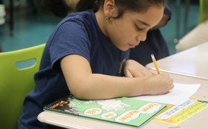 girl working on a dr. seuss activity