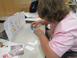 Teddy Reynolds uses the instructions to build this Foldscope