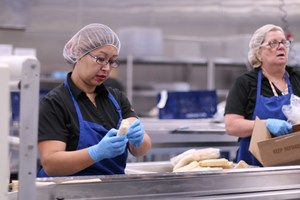Staff preparing food to be sent to school sites.