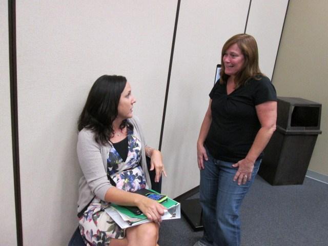 Teachers talking during training.