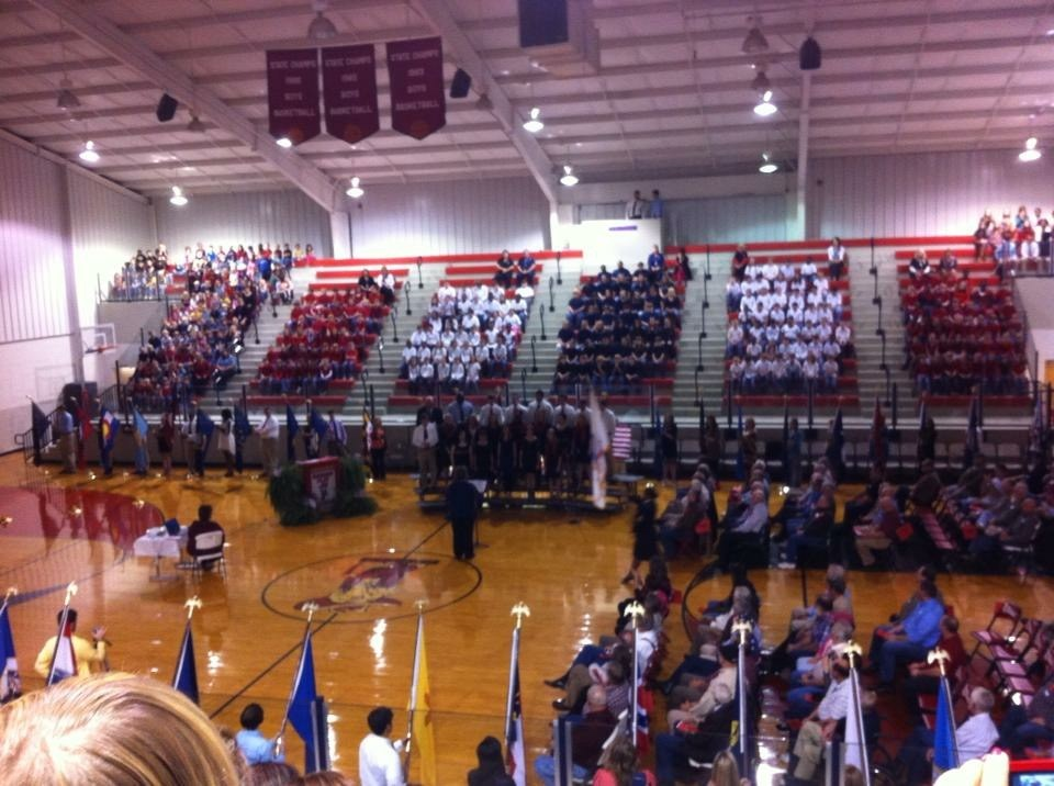 gym with students singing in stands