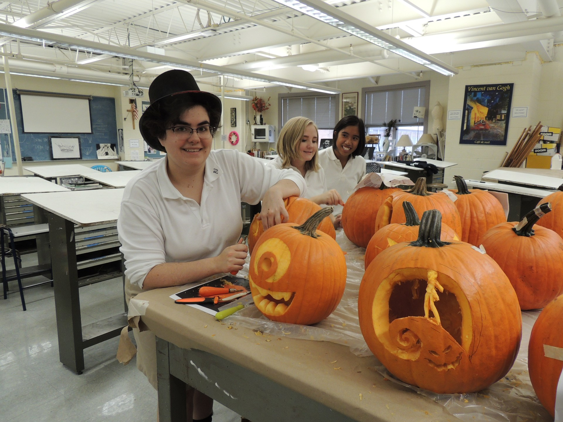 Student carving pumpkins in art room