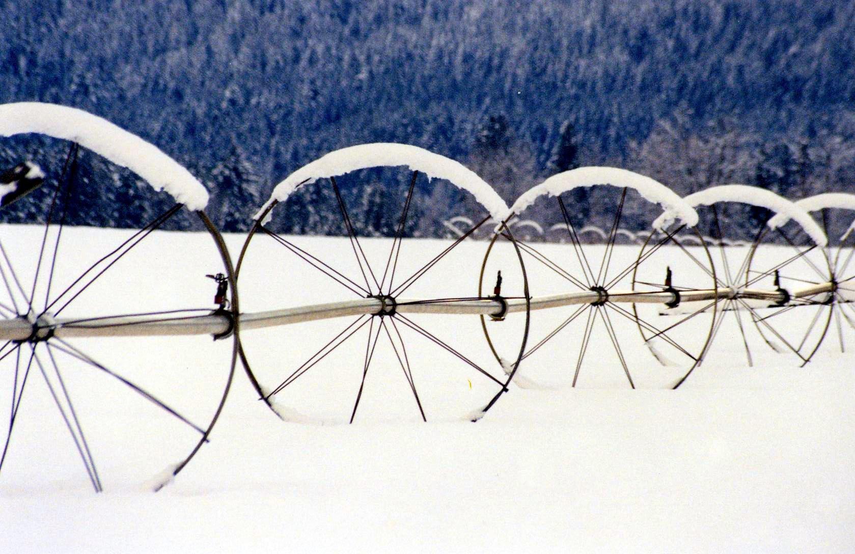Photo of irrigation wheels with snow, Husum, WA.