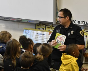 Glen Woolsey, a Johnson County Sheriff's Deputy and Alvarado ISD School Resource Officer, reads to Charlene Hodge's kindergarten class.