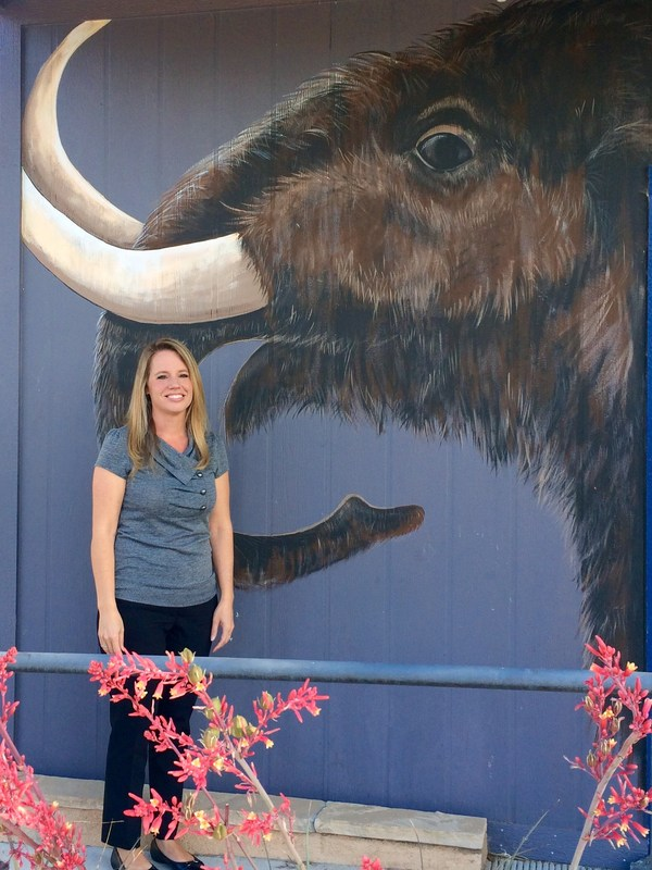 Maura Trujillo in front of the Western Center mammoth