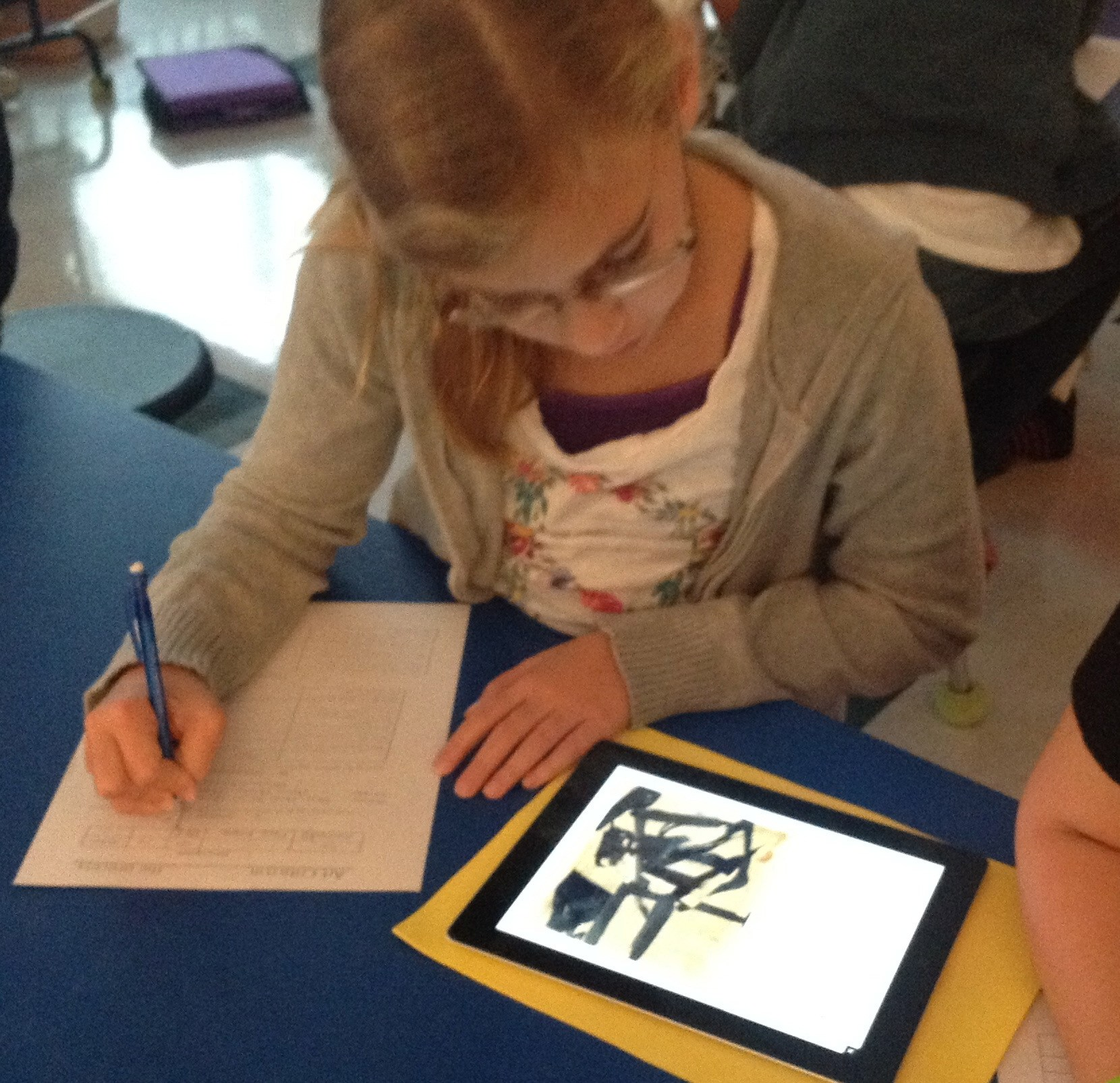 Student working with iPad