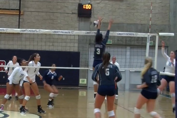 Liberty sweeps 1st round volleyball playoff match Thumbnail Image