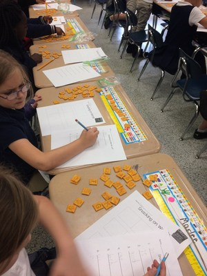 Students in Caitlyn McFarland's first grade class used Scrabble Cheezits (each Cheezit has a letter on it) to create known words.