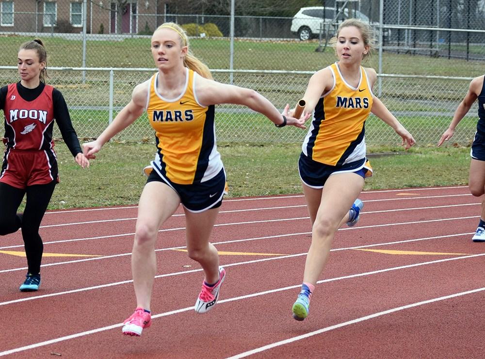 girls running on track