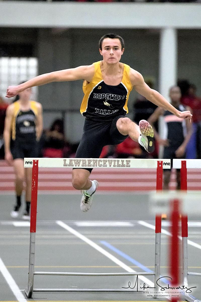 CHS boys track runner clears a hurdle