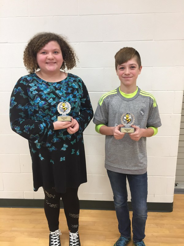 photo of boy and girl with their awards
