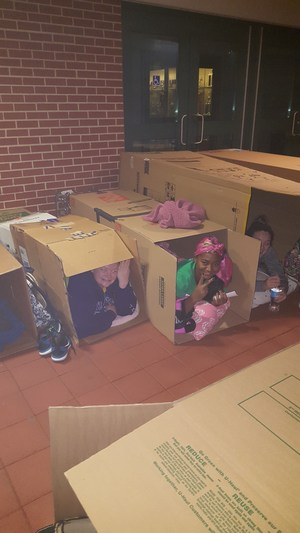 OLSH students sleep outside in boxes to raise awareness about homelessness.
