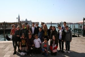 students in Venice in front of water