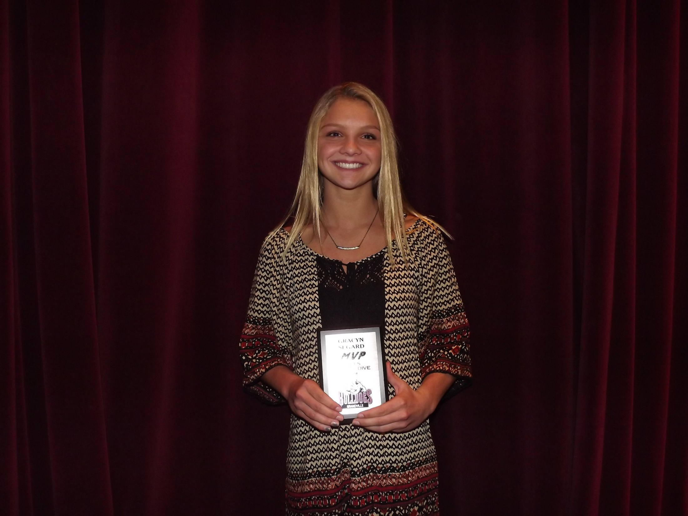 girl with diving MVP award