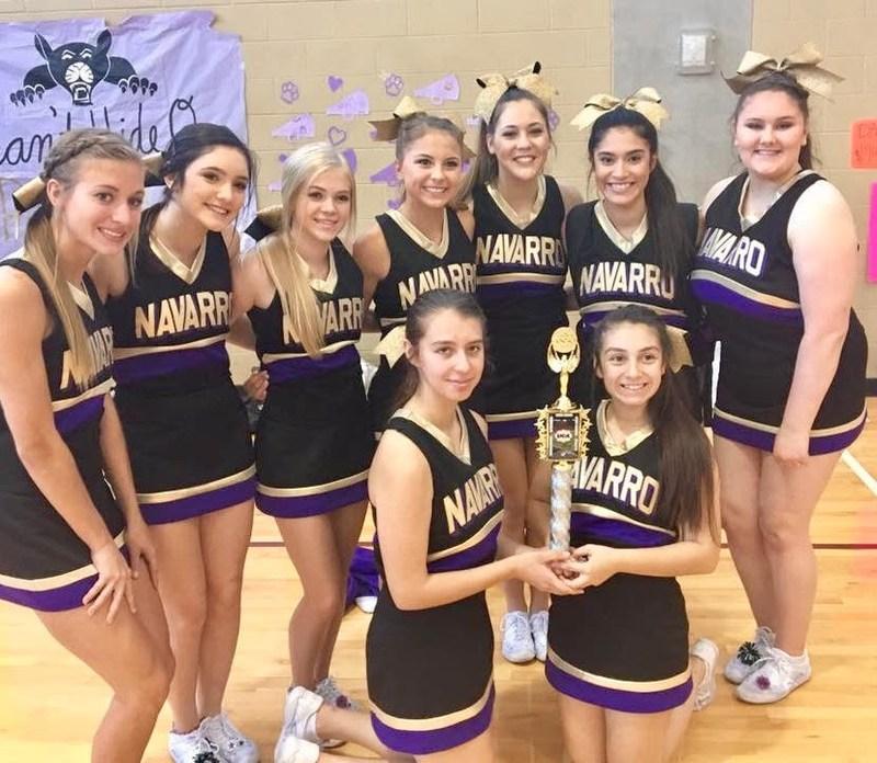 Varsity Cheerleading Squad holding trophy