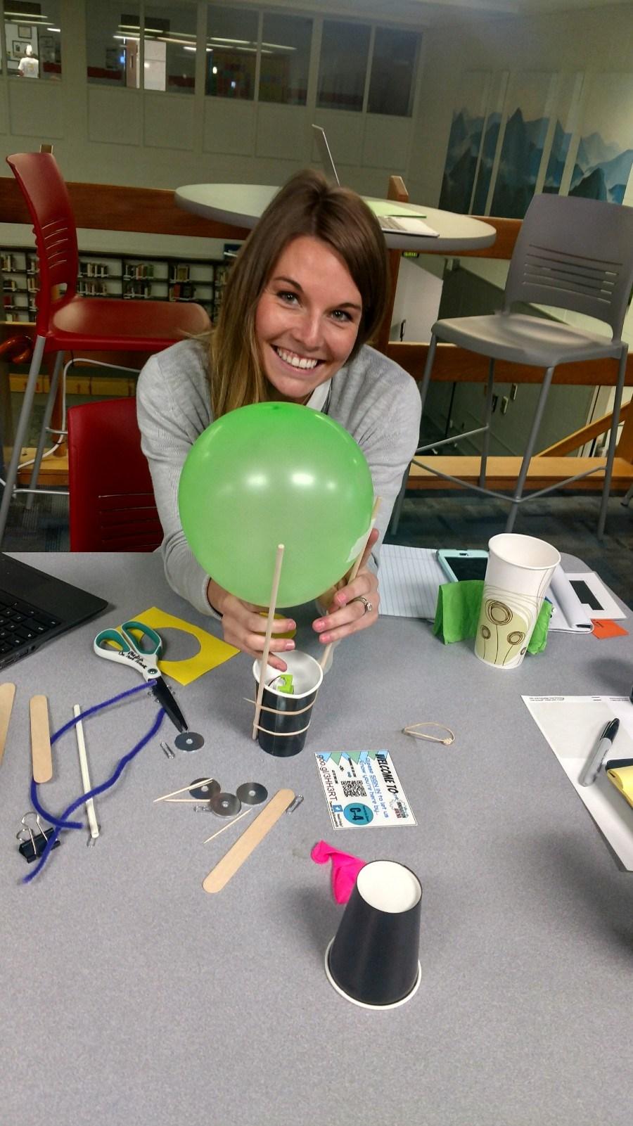 Beginning Teacher works on balloon activity