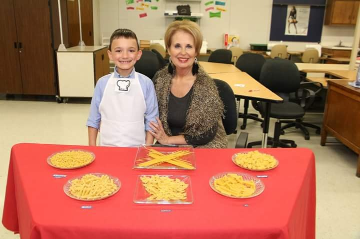 Teacher and student wit pasta
