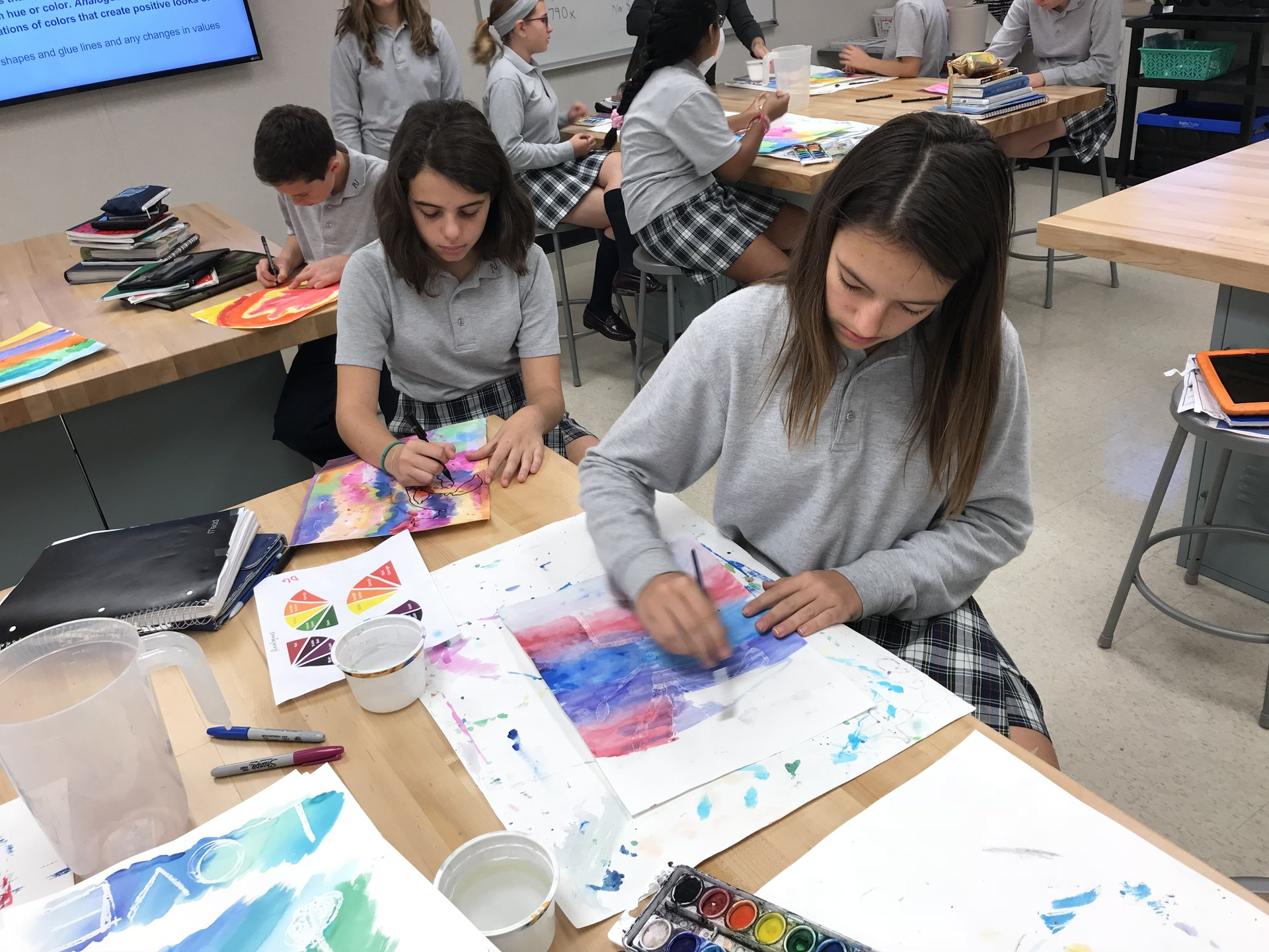 Two girl students paint pictures