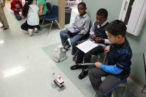 Pioneer Crossing Students showing off their robotic vehicles at PBL Symposium=