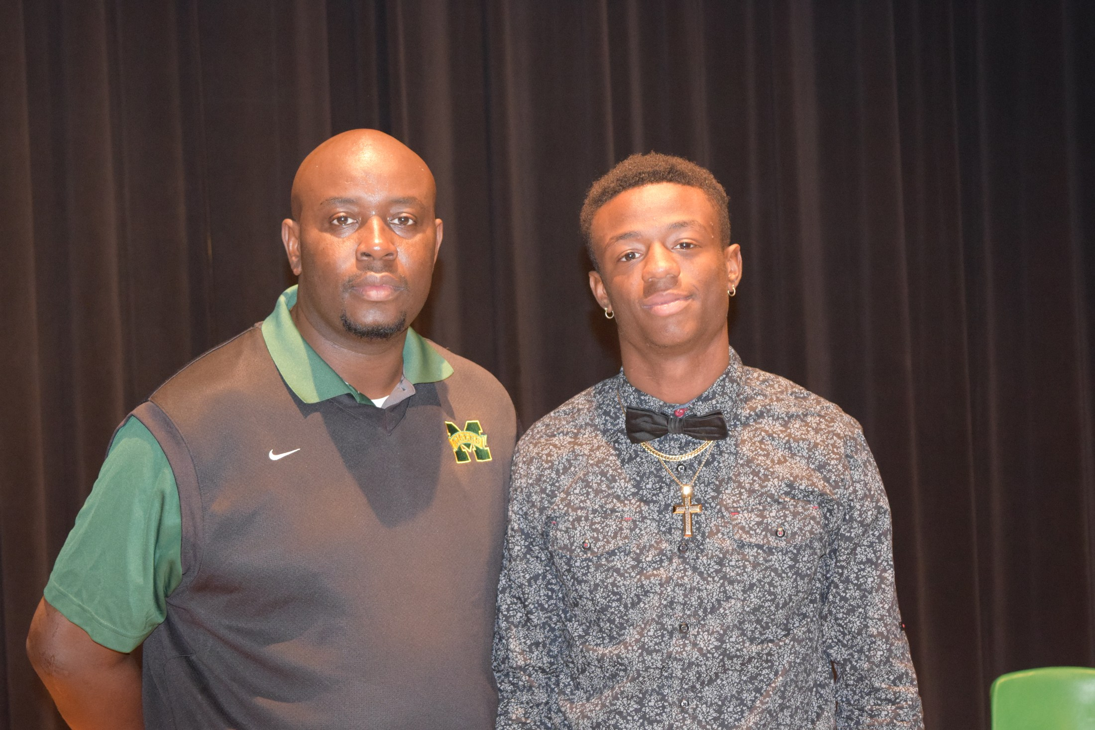 Coach Bo with student on signing day