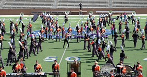 Band marching on football field