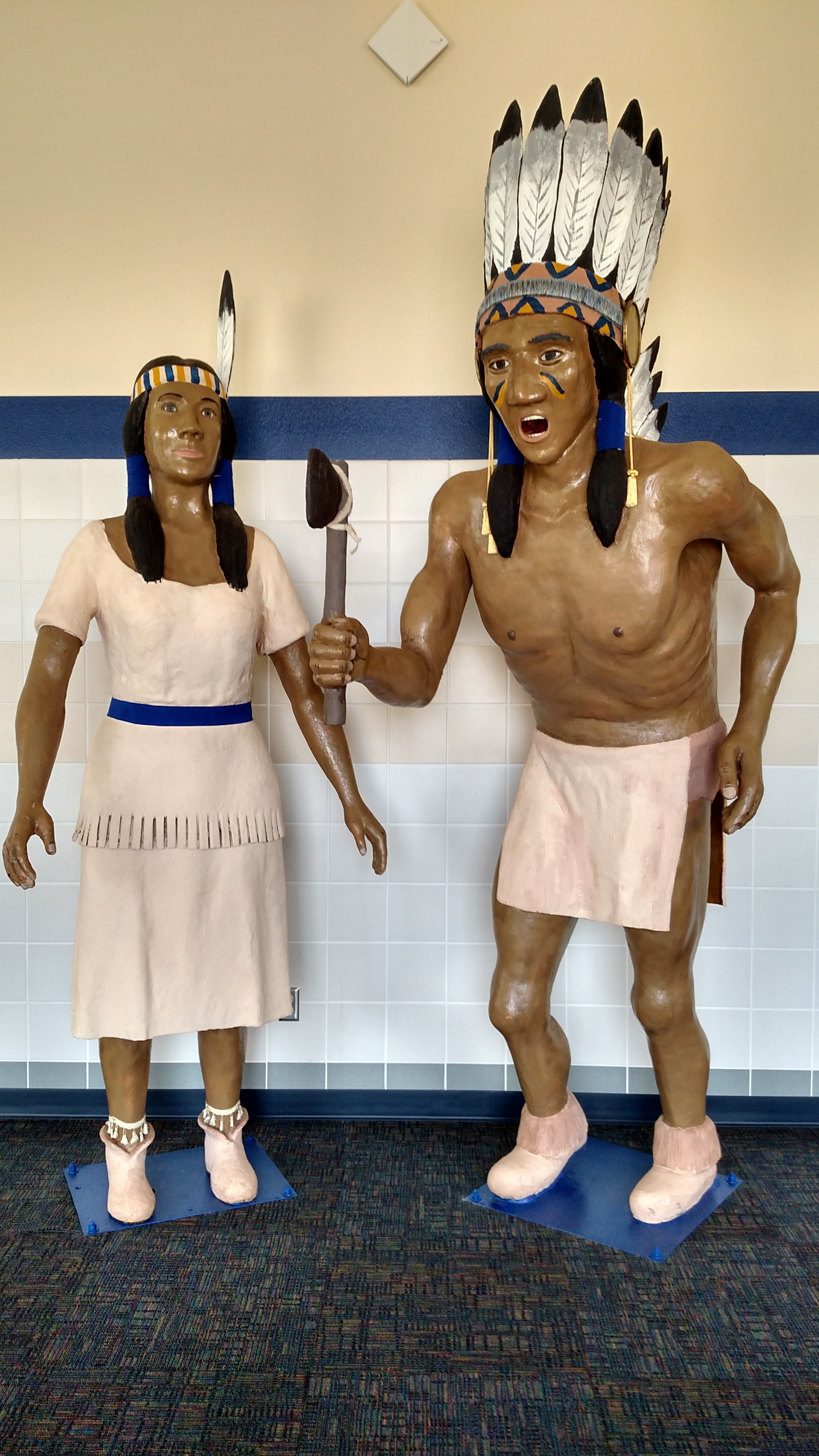 Indian and Maiden mascots in the JHS Student Commons