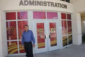 Gerardo Zavala in front of a Hemet High sign.