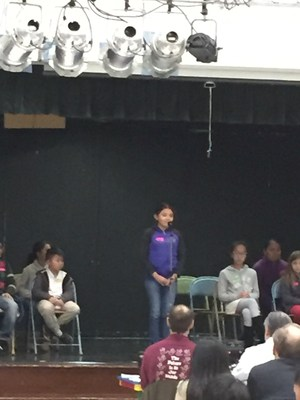 spelling bee contestant on stage