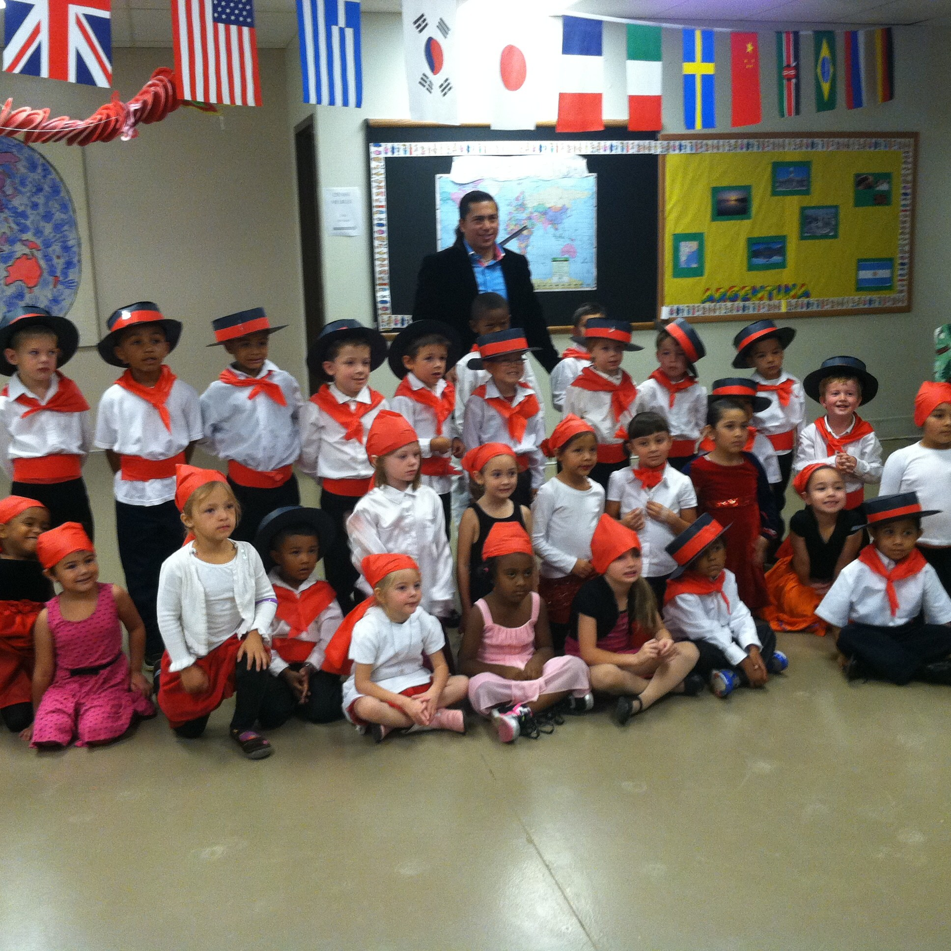 First grade girls and boys in traditional Spanish cultural costumes for Spanish Culture Night