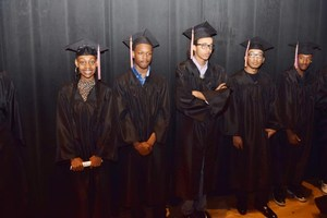 Invictus High School students wait backstage before receiving their diplomas