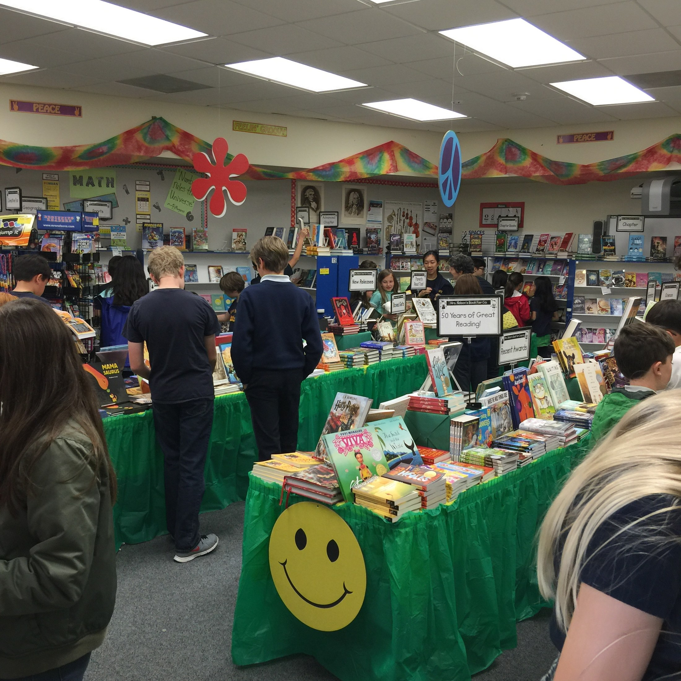 Students shopping at book fair.
