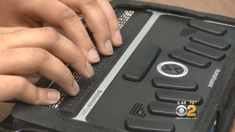 Closeup of a student using a Braillenote