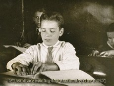 1917 students reading Braille
