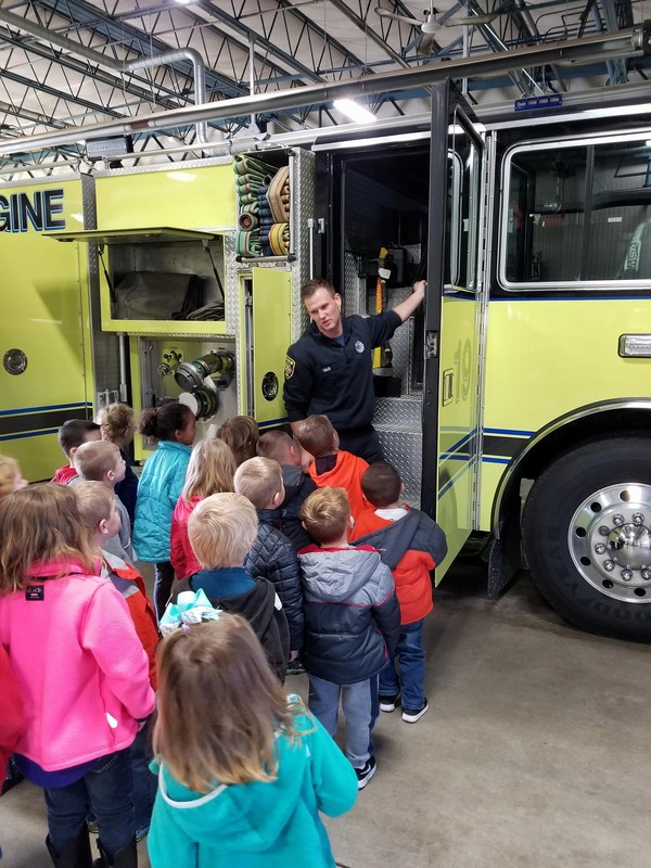 students in front of fire truck