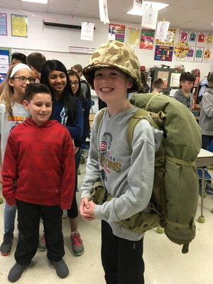 Student tries on WWII backpack