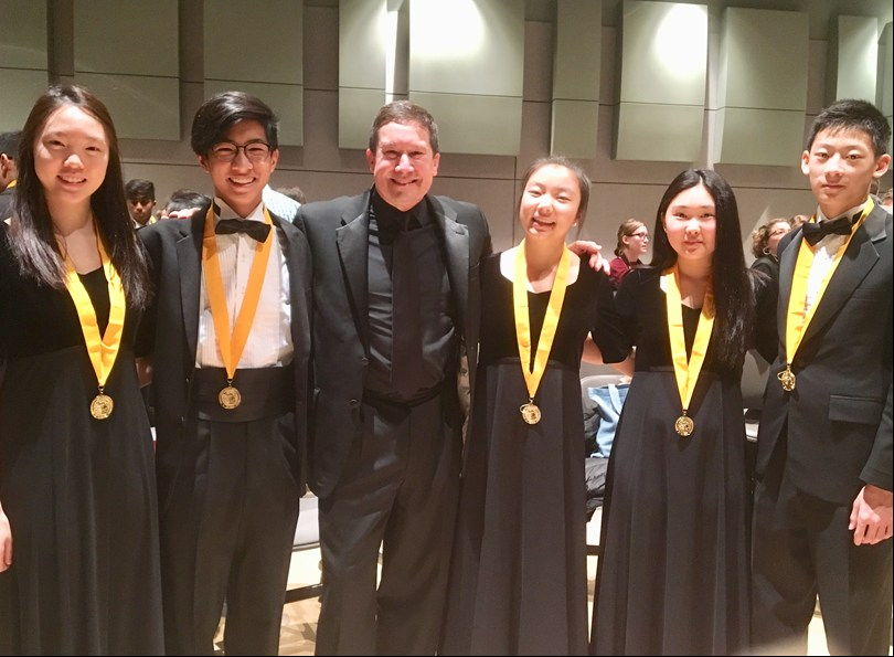 Five Troy Colt Band students participated in the MSBOA All-State Band at the Michigan Music Conference.  They performed under the direction of Dr. Scott Boerma, current Director of Bands at Western Michigan University.    Sara Huang, John Dannug, Dr. Boerma, Michelle Baek, Lilian Xiao and Aaron Feng representing THS.