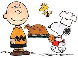 Charlie Brown and Snoopy holding a turkey